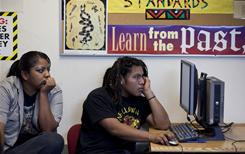 High school seniors Jesse Pablo and Ivina Hendricks work online during class.  Arizona reservations are getting federal stimulus funding to expand high-speed Internet  access.