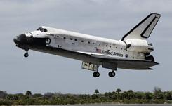 Space shuttle Discovery lands at the Kennedy Space Center in Cape Canaveral, Wednesday.