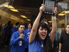 A cheer goes up as the iPad 2 goes on sale at The Grove Apple store in Los Angeles Friday.