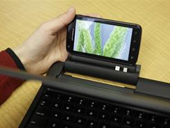 The new Motorola Atrix smart phone can plug into a laptop-like docking station.