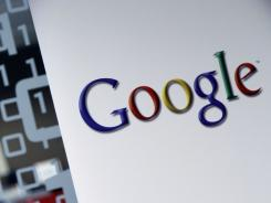In this March 23, 2010 photo, the Google logo is seen at the Google headquarters in Brussels. Microsoft Corp. on Thursday, March 31, 2011, threw its weight behind an existing probe by European Union authorities into whether rival Google Inc. is unfairly thwarting competition in the online search market.