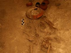 The skeleton of the suspected 350 BC ruler, interred with pots covering his skull, a Mayan custom.