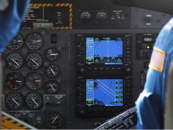 A cockpit GPS shows the search area as scientists participate in a marine mammal/sea turtle survey flight related to the Deepwater Horizon oil spill on a National Oceanic and Atmospheric Administration twin otter DHC-6, over the Gulf of Mexico near the Chandeleur Islands off the Louisiana coast. About 40 percent of commercial and private planes rely on GPS navigation systems.