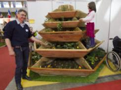 Jean Marc Batard of France presents his invention: a vertical garden which allows elderly people to garden. It can also be used by people who love gardening but cannot bend down.