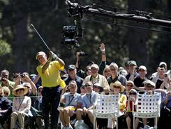 Jack Nicklaus tees off on Wednesday. A camera, affectionately known as WALL-E with its two lenses reminiscent of the eyes on the animated movie robot, shoots sports in 3-D.