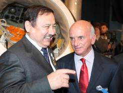Cosmonaut Talgat Musabayev of Russia (L) and Dennis Tito, the world's first space tourist, as a reception devoted to the 50th anniversary of Yuri Gagarin's historic first space flight.