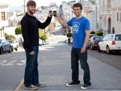 "Jake Mintz, right, and David Lieb are co-founders of Bump, an iPhone app that's a digital business card replica. Just open the app, ""bump"" two phones together, and you get contact information beamed directly to the phone. Now you can also share photos, music snippets and favorite apps with Bump."