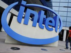 The Intel logo is displayed at the entrance of Intel headquarters in Santa Clara, Calif.