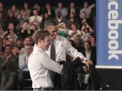 President Obama and Facebook CEO Mark Zuckerberg take off their jackets before the start of the town hall meeting.