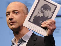CEO Jeff Bezos with the Kindle DX.
