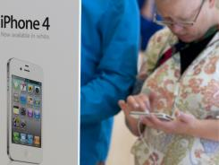customer looks at the new white iPhone 4 at the Apple store in Palo Alto, California.