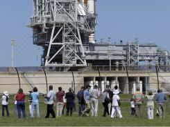 Visitors at the Kennedy Space Center in Cape Canaveral, Fla. get a close view of space shuttle Endeavour.