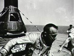 Astronaut Alan Shepard on U.S. Champlain after recovery of Mercury capsule.