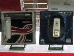 In this photo taken Feb. 17, 2011, mobile Internet devices of Huawei Technologies Ltd., right, and ZTE Corp, left, are displayed for sale at a computer mall in Beijing.