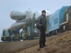 A Russian policeman monitors the transport of the Soyuz TMA-21rocket on April 2.