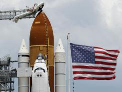 Space shuttle Endeavour sits on the launch pad Sunday at the Kennedy Space Center in Cape Canaveral.