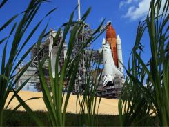 The space shuttle Endeavour sits on launch pad 39-A at the Kennedy Space Center on Sunday.