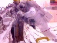 In a photo made from NASA Television, astronaut Greg Chamitoff  works during a spacewalk Friday.