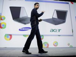 Google's Sundar Pichai displays Acer and Samsung notebooks running on the Chrome operating System.