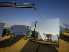 BrightSource Energy employees assemble heliostats during construction of the Solar Energy Development Center.