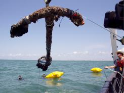 3,000 pound anchor from what is believed to be the wreck of the pirate Blackbeard's flagship, the Queen Anne's Revenge, was recovered from the ocean on Friday.
