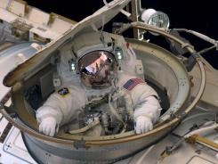 Astronaut Andrew Feustel reenters the space station after completing a spacewalk on May 22.
