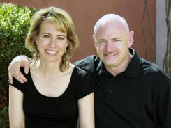 NASA's Mark Kelly and Gabrielle Giffords reunite after weeks apart while he was in space.