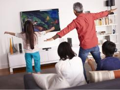 A family plays &quot;Kinect Disney Adventures,&quot; where players can fly on the Peter Pan Neverland ride.
