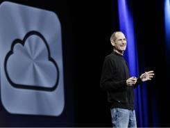 Apple CEO Steve Jobs introduces iCloud during a keynote address to the Apple Worldwide Developers Conference in San Francisco.