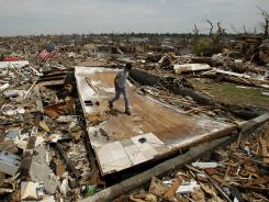 Patrick O'Banion salvages items from his home in Joplin, Mo., that was destroyed by an EF-5 tornado on May 22.