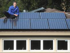 Lyndon Rive with solar panels atop his Belmont, Calif., home in 2009.