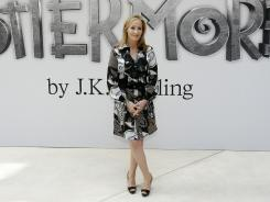 British author J.K. Rowling poses for photographers as she announces her new website project Pottermore at the Victoria and Albert Museum in London on June 23.