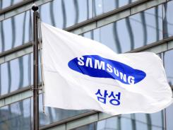 A flag for the South Korea-based company Samsung Electronics flies in Seoul in April.  The company is asking for the United States to ban imports of key Apple products, such as the new iPhone and iPad.