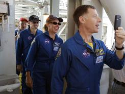 Space shuttle Atlantis commander Chris Ferguson  and astronauts Sandy Magnus,  Rex Walhiem and  Doug Hurley.