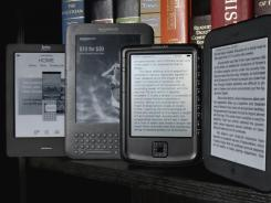 The Kobo eReader Touch, an Amazon Kindle, an Aluratek Libre Air, and a Barnes & Noble Nook, left to right, are displayed.