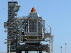 Storms may delay the launch date of NASA's last space shuttle mission, which is set for liftoff Friday in Cape Canaveral, Fla.