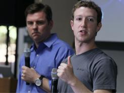 Facebook CEO Mark Zuckerberg, right, and Skype CEO Tony Bates speak during a news conference.