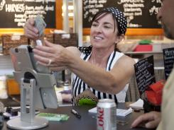 Owner Colleen Dobbs of crepe shop Three Days in Paris. Paperless receipts have been embraced by smaller businesses.