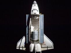 In this photo provided by NASA, space shuttle Atlantis and its payload is shown while in orbit.