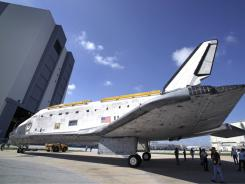 Space shuttle Discovery is moved from a processing center Wednesday at Kennedy Space Center. It will move to the National Air and Space Museum in April.