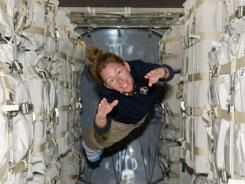 NASA astronaut Sandy Magnus floats aboard the International Space Station.
