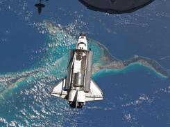 The space shuttle Atlantis as it approaches the International Space Station for docking.