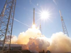 The SpaceX Falcon 9 rocket launching at Cape Canaveral, Fla. The company is preparing a launch site for its larger Falcon Heavy rocket.