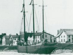 A mid-1800s Canadian schooner, Queen of the Lakes, is shown.