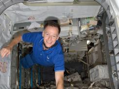 Atlantis astronaut Chris Ferguson proudly finishes moving supplies between shuttle and space station.