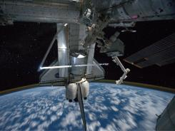 The space shuttle Atlantis while still docked with the International Space Station earlier this week.
