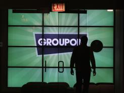 The Groupon logo is displayed in the lobby of the company's headquarters in Chicago.