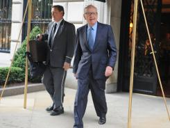 Rupert Murdoch exits his Fifth Avenue residence in New York City on Thursday.