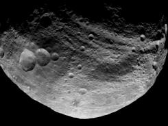 This image released by NASA/JPL shows the dark side of the Vesta asteroid captured by NASA'S Dawn spacecraft on July 23 and taken from a distance of about 3,200 miles away.