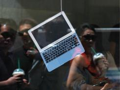 A MacBook Air displayed in the window of an Apple Store in San Francisco.